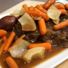Slow Cooker Roast Beef in its own Gravy - Slow cooker roast beef served with potatoes and carrots is topped with rich gravy made from reduced cream of celery soup in the slow cooker.