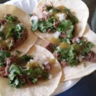 Slow Cooker Lengua (Beef Tongue)  - Slow cooker lengua, also known as beef tongue, is a surprisingly tender meat. Serve in tacos with onion, tomato, cilantro, and lime wedges.
