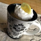 Lemon Cake in a Mug - Lemon cake in a mug topped with a simple lemon sauce is ready in minutes for a quick snack or dessert.