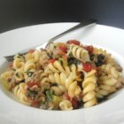 Tomato, Spinach, and Cheese Pasta - This easy weeknight meal has baby spinach hidden in melted cheese and tomatoes. Your kids will love it!