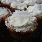 Lemon Coconut Cupcakes - Coconut cupcakes are topped with lemon cream cheese frosting and a sprinkling of more coconut for a refreshing and decadent treat.