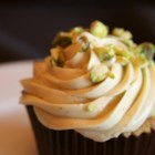 Chocolate-Orange Cupcakes with Pistachio Buttercream - Chocolate and orange cupcakes are topped with pistachio buttercream icing for a festive treat for Halloween.