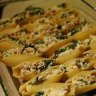 Cheesy Stuffed Shells - This is a delicious baked pasta dish with large shells filled with meat, spinach and cheese that children always seem to love. It is kind of a 'spaghetti that behaves itself!'