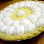 Key Lime Pie I - Beaten egg whites are carefully folded into the lovely lime filling to create a light and airy texture. The pie is baked in a graham cracker crust, frozen and topped with freshly whipped cream just before serving.