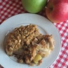 Apple Crisp II - Apples in syrup snuggled between oaty cinnamon-crumble layers and baked.