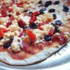 Pizza On The Grill I - With this recipe, you'll make the garlic and basil pizza dough from scratch, and learn the tricks of grilling a perfect pizza that features tomatoes, olives, roasted red pepper, and basil. Makes two medium pizzas.