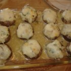 Stuffed Mushrooms with Swiss Cheese - Swiss cheese tops these mushrooms stuffed with a creamy mixture flavored with onion and parsley.
