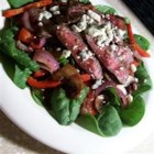 Flat Iron Steak and Spinach Salad - Spinach is topped with peppers, mushrooms and steak in this recipe.