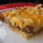 Breakfast Pizza I - A crust made from dinner roll dough with sausage, hash browns and cheese on top.