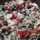 Vegetable Wild Rice Salad - Wild rice is mixed with a variety of colorful vegetables in a simple vinaigrette dressing creating a salad that will be the star of the party at your next pot luck.