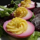 Deviled Pickled Eggs - Deviled eggs made from eggs pickled in a beet juice brine are a colorful addition to the appetizer table and perfect when watching the big game or Easter.