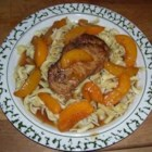 Peachy Pork Chops - Luscious peaches are infused with a dash of ginger and a touch of brown sugar to make a delectable sauce for sauteed pork chops in this fast and easy simmered entree.