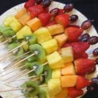 Fruity Fun Skewers - A fun, beautiful, and distinctive way to serve fruit at your next party! Try these fruit skewers out with a variety of fruit dips to make them even more exciting!
