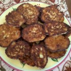 Mom's Zucchini Pancakes - Crispy pan-fried vegetable pancakes make an easy side dish or appetizer. Serve with sour cream.