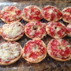Easy Mini Bagel Pizzas - Mini pizza bagels make a quick and easy meal kids and adults will love to create for themselves.