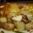 Dad's Kentucky Home Fries - Golden-brown fried potatoes made with bacon drippings and sweet Vidalia(R) onion. Leftovers keep well in the fridge for a microwave breakfast on the go. For an East Coast twist, add diced green pepper.