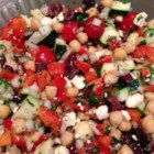 Mediterranean Zucchini and Chickpea Salad - This Mediterranean-inspired salad is loaded with chickpeas, oregano, Kalamata olives, tomatoes, feta, and much more for a filling and savory side dish.