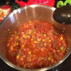 Taco Stew - Ground beef and onions sauteed with a packet of taco seasoning mix are combined in this stew with canned tomatoes, whole kernel corn and ranch-style baked beans.