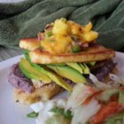 Vegan Arepas Made with Polenta - Layers of polenta, tofu, bananas, avocado, and mango salsa combine for a surprising and simple meal.