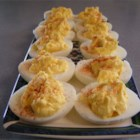 Deviled Eggs - Place eggs in saucepan and cover with water. Bring to boil. Cover, remove from heat, and let eggs sit in hot water for 10 to 12 minutes. Remove from hot water and cool.