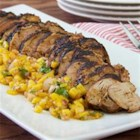 Chili-Rubbed Pork with Mango Salsa - Chili-rubbed pork tenderloin gets a flavorful crust when cooked on the grill. Top with a mango salsa for a delectable summertime dinner on the patio.