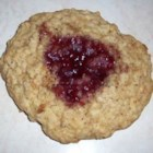 Oatmeal Thumbprints - These oatmeal cookies with almonds have a raspberry filling for a delightful fruit-and-nut blend.
