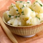 Grammy's German Potato Salad - This German-style potato salad is mayonnaise-free and served warm in a dressing made with cider vinegar and dry mustard.