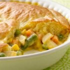 Impossibly Easy Chicken Pot Pie - This pot pie couldn't be easier. It's loaded with chicken and vegetables in a creamy sauce and baked under an impossibly easy crust.