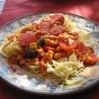 Al's Quick Vegetarian Spaghetti - A bevy of veggies, corn, broccoli, carrots and mushrooms  are simmered in tomato sauce until gently cooked, and then napped over al dente spaghetti.