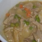 Chicken and Dumplings III - Boneless skinless chicken thighs are cooked in water and a can of cream of celery soup in this stew with refrigerated biscuits for dumplings.