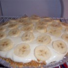 Banana Cream Pie Made Easy - Whipped cream is combined with vanilla and banana instant pudding, layered with bananas in a pie shell, and topped with more whipped cream.