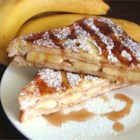 Peanut Butter and Banana French Toast - An unique and delicious recipe that my mom used to make. It is so easy that even kids can help to make it. Serve it hot with butter or margarine and syrup.