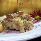 Couscous-Stuffed Pork Chops - Pork loin chops are stuffed with a mixture of couscous, currants, and pine nuts, then coated in marmalade, and baked.