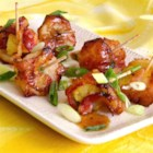 Easy Rumaki with Pineapple - Pineapple cubes and water chestnuts are wrapped in bacon, brushed with sesame-ginger dressing, and baked into a quick and easy rumaki appetizer.