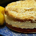 Italian Lemon Cream Cake - Homemade Italian lemon cream cake filled with lemon cream and topped with vanilla crumbs is just like the one at a famous Italian restaurant chain.