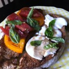 Caprese on Toast - These crostini-type appetizers are simply slices of sourdough bread rubbed with garlic cloves and topped with sliced mozzarella cheese, a few basil leaves, and slices of ripe tomato. A drizzle of olive oil and a sprinkle of salt and black pepper finish the caprese salad appetizers.