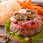 Blue Cheese Stuffed Burgers  - Sharp, creamy blue cheese wrapped inside juicy burgers and topped with grilled mushrooms and onions make for a perfect summer dinner.