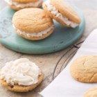 Snickerdoodle Sandwich Cookies - Creamy, cinnamon-spiced frosting sandwiched between two soft snickerdoodles makes for one tasty treat.