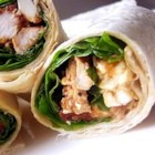 Chicken, Feta Cheese, and Sun-Dried Tomato Wraps - A mixture of grilled chicken, feta, and spinach is wrapped in a flour tortilla and grilled.