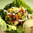 Corn, Sweet Onion, and Tomato Salad - An exciting, cool and refreshing side salad that goes great with grilled meat. Fantastic for get-togethers. It's also really quick and easy to prepare...no cooking needed!