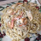 Grilled Shrimp and Chicken Pasta - A wonderful creamy pasta in a delicious wine sauce, loaded with grilled shrimp and chicken.