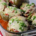 Italian-Style Stuffed Peppers - Stuffed peppers take on an Italian feel with the help of Classico(R) Fresh Tomato & Basil Sauce, Italian sausage, Parmesan cheese, and Italian seasonings.  It's comfort food kicked up a notch--and gluten free!