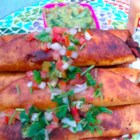 Spicy Alfredo Chicken Bacon Taquitos - A unique twist on the rolled taco, these spicy chicken taquitos are quickly pan fried until golden brown. Serve with guacamole and pico de gallo.