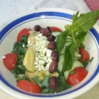 Midsummer Night's Salad - Fresh mint, salad greens, cucumber and a delicious mix of lemon and olive oil make this a wonderfully cool and refreshing salad for any time. This would be lovely on the side of an omelet for breakfast, or grilled fish at dinnertime.