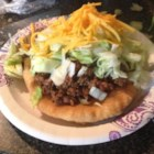 Oklahoma Indian Tacos - Easy-to-make fry bread needs just two ingredients, self-rising flour and buttermilk. Top the golden brown fried breads with a spicy ground beef and bean mixture, then garnish with your favorite taco trimmings.