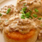 Italian Sausage Gravy and Biscuits - This easy biscuits and gravy recipe uses Italian sausage, creamy Alfredo sauce, and sage for a delicious brunch or weeknight dinner.
