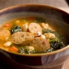 Spanish Style White Bean and Sausage Soup - Andouille sausage and kale are great additions to this white bean soup. This soups flavor is blended perfectly. It is a real taste bud pleaser.