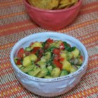 Refreshing Avocado, Tomato, and Mango Salsa - You get a refreshing combination of sweet, savory, and spicy all in one salsa recipe combining tomato, mango, avocado, and jalapeno pepper.