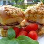 Hawaiian Ham and Cheese Sliders - Ham and cheese sliders made with Hawaiian sweet rolls and a buttery poppy seed sauce are great for potlucks and quick and easy to prepare.