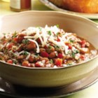 Beef and Bean Chile Verde - Chile Verde, usually a slow-cooked stew of pork, jalapenos and tomatillos, becomes an easy weeknight meal with quick-cooking lean ground beef and store-bought green salsa.